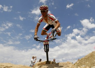 Image: Hungary's Andras Parti reacts as he falls during the men's cross-country mountain bike event  during the London 2012 Olympic Games