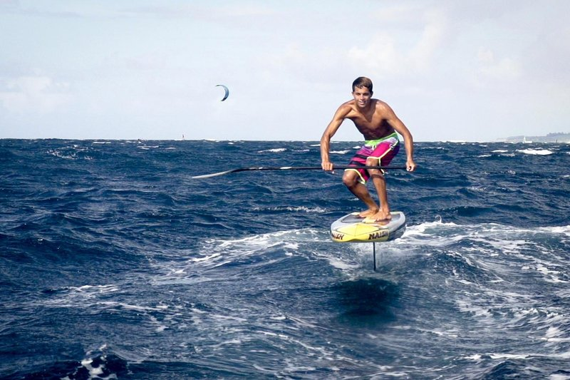 kai-lenny-foiling-above-the-ocean-whilst-testing-a-new-type-of-sup-in-hawaii